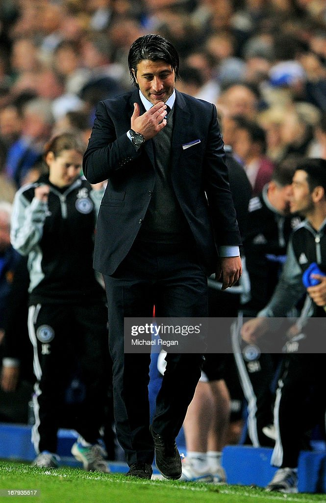 A dejected Murat Yakin the Basel head coach walks away following his team's 3-1 defeat during UEFA Europa League semi final second leg match between Chelsea and FC Basel 1893 at Stamford Bridge on May 2, 2013 in London, England.