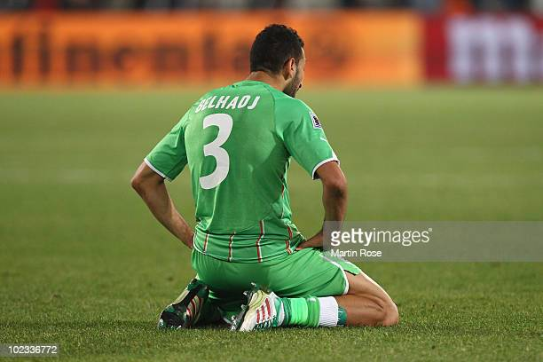 A dejected Nadir Belhadj of Algeria after defeat and elimination in the 2010 FIFA World Cup South Africa Group C match between USA and Algeria at the...