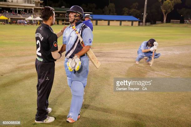 A dejected Nathan Price of New South Wales is seen as Ben Abbatangelo of Victoria shakes hands with Ben Abbatangelo after the National Indigenous...