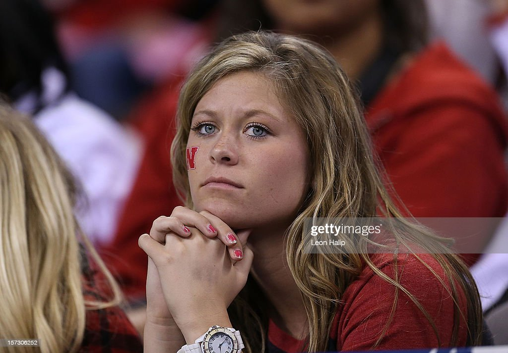 A dejected Nebraska Cornhuskers fan watches the action during the game against the Wisconsin Badgers at Lucas Oil Stadium on December 1, 2012 in Indianapolis, Indiana. The Badgers defeated the Cornhuskers 70-31
