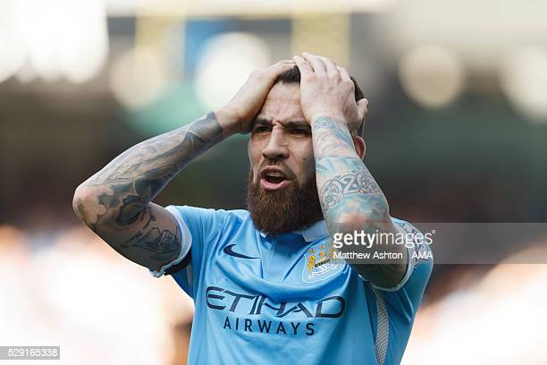 A dejected Nicolas Otamendi of Manchester City during the Barclays Premier League match between Manchester City and Arsenal at the Ethiad Stadium on...