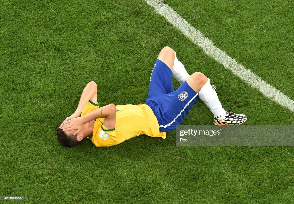A dejected Oscar of Brazil lies on the pitch after being defeated by Germany 71 during the 2014 FIFA World Cup Brazil Semi Final match between Brazil...