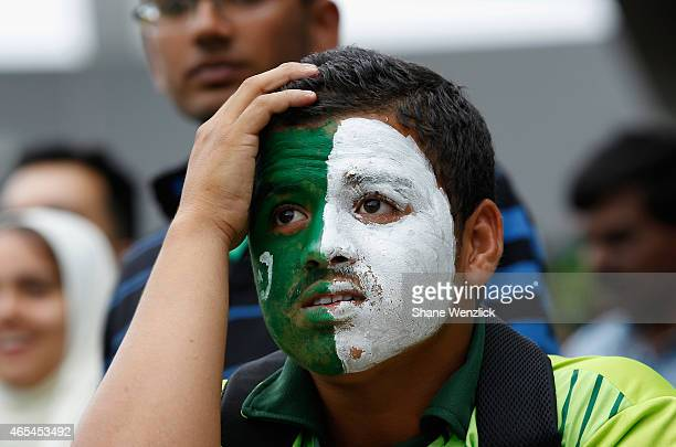 A dejected Pakistan fan after a batsman is given out during the 2015 ICC Cricket World Cup match between South Africa and Pakistan at Eden Park on...