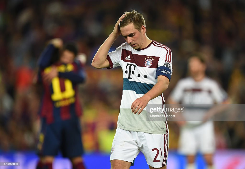 A dejected <a gi-track='captionPersonalityLinkClicked' href=/galleries/search?phrase=Philipp+Lahm&family=editorial&specificpeople=483746 ng-click='$event.stopPropagation()'>Philipp Lahm</a> of Bayern Muenchen reacts following his team's 3-0 defeat during the UEFA Champions League Semi Final, first leg match between FC Barcelona and FC Bayern Muenchen at Camp Nou on May 6, 2015 in Barcelona, Spain.