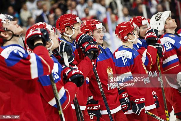 Dejected players of Russia react after loosing to Finland after the end of the 2016 IIHF World Junior Ice Hockey Championship final match Finland vs...