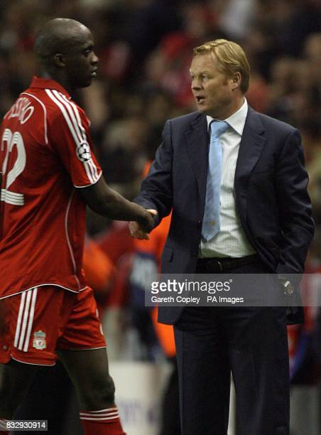 A dejected PSV Eindhoven's coach Ronald Koeman shakes hands with Liverpool's Mohamed Sissoko after the final whistle