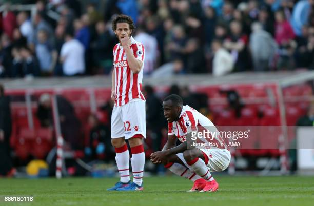 A dejected Ramadan Sobhi and Saido Berahino of Stoke City at full time after the Premier League match between Stoke City and Liverpool at Bet365...