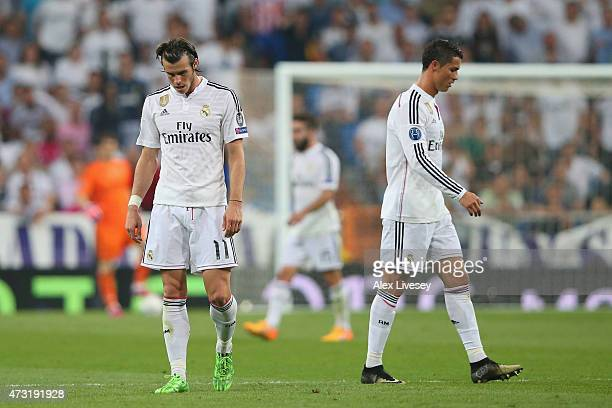 Dejected Real Madrid teammates Gareth Bale and Cristiano Ronaldo walk off the pitch following their team's exit from the competition during the UEFA...