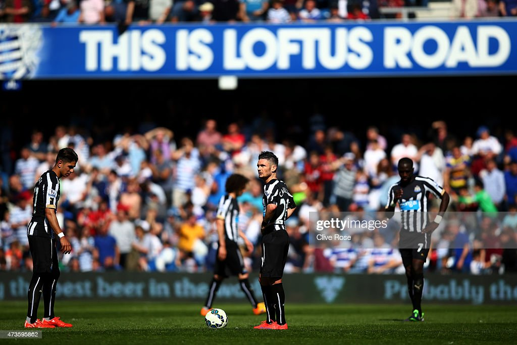 A dejected Remy Cabella of Newcastle United (C) looks on after connceding a second goalduring the Barclays Premier League match between Queens Park Rangers and Newcastle United at Loftus Road on May 16, 2015 in London, England.