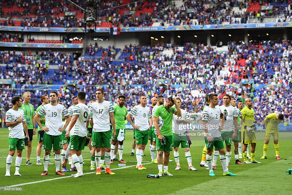 Dejected Republic of Ireland players are seen on the pitch after their team's 1-2 defeat in the UEFA EURO 2016 round of 16 match between France and Republic of Ireland at Stade des Lumieres on June 26, 2016 in Lyon, France.