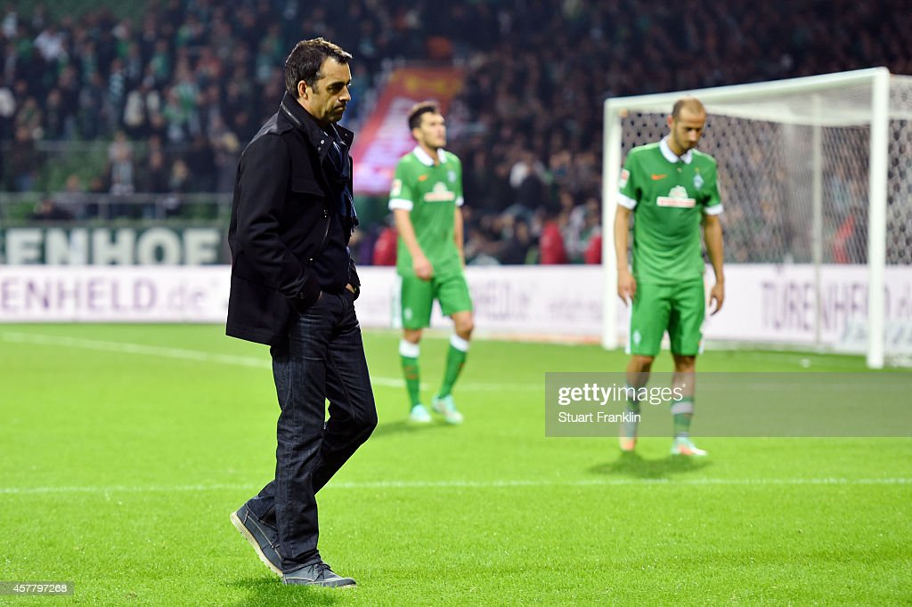 A dejected Robin Dutt the manager of Werder Bremen walks off the pitch following his team's 10 defeat during the Bundesliga match between SV Werder...