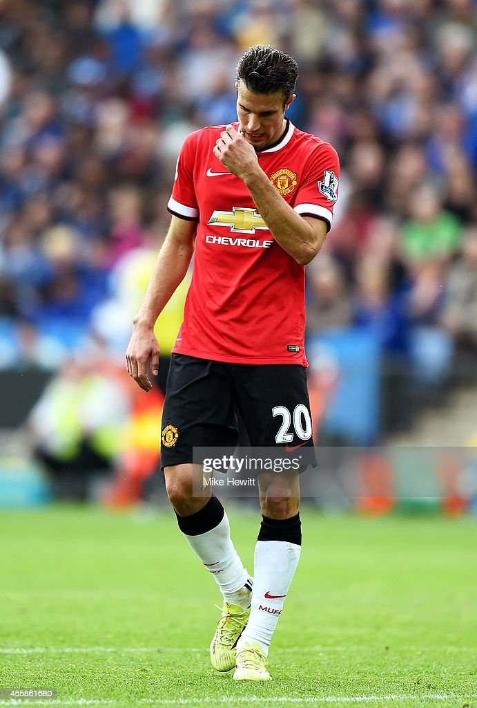 A dejected Robin van Persie of Manchester United looks on following his team's 5-3 defeat during the Barclays Premier League match between Leicester City and Manchester United at The King Power Stadium on September 21, 2014 in Leicester, England.