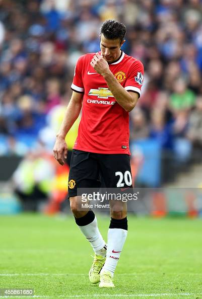 A dejected Robin van Persie of Manchester United looks on following his team's 53 defeat during the Barclays Premier League match between Leicester...