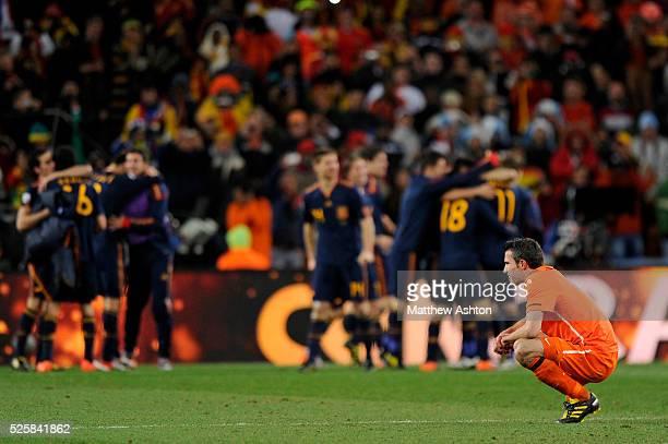 A dejected Robin Van Persie of Netherlands as Spain celebrate victory