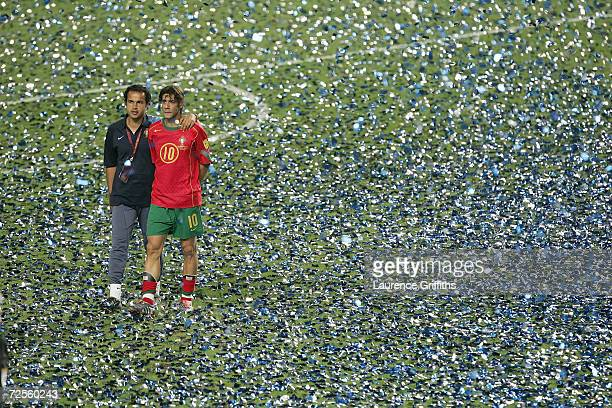 A dejected Rui Costa of Portugal walks off the pitch after losing the UEFA Euro 2004 Final match between Portugal and Greece at the Luz Stadium on...