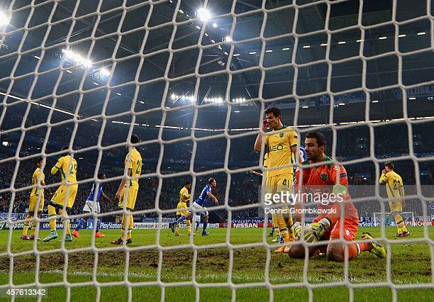 A dejected Rui Patrcio of Sporting Lisbon looks on after Benedikt Hoewedes of Schalke scored their third goal during the UEFA Champions League Group...
