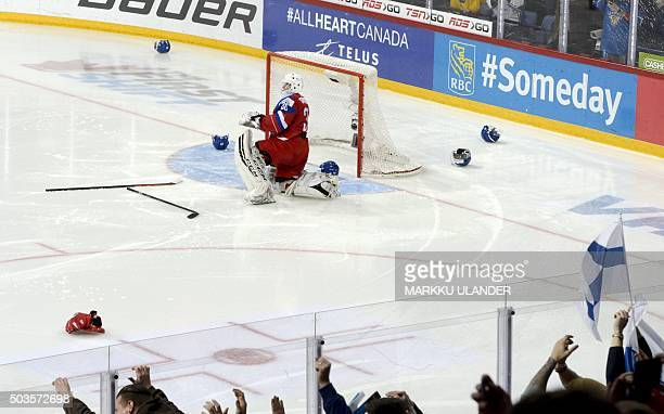 Dejected Russian goalkeeper Alexander Georgiev is seen alone at his goal after the 2016 IIHF World Junior Ice Hockey Championship final match Finland...