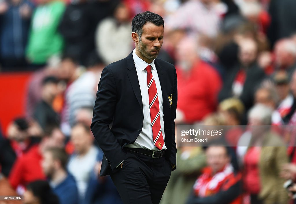 A dejected Ryan Giggs the Manchester United interim manager walks off the pitch following his team's 1-0 defeat during the Barclays Premier League match between Manchester United and Sunderland at Old Trafford on May 3, 2014 in Manchester, England.