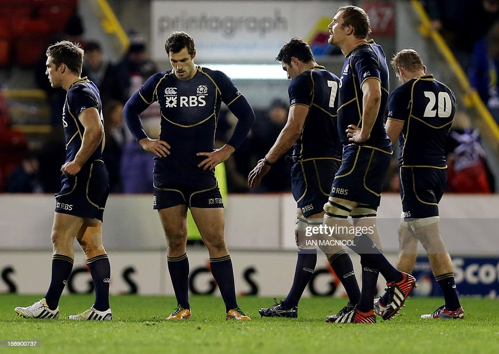 Dejected Scotland players gesture at the final whistle during the International rugby union test match between Scotland and Tonga at Pittodrie in Aberdeen on November 24, 2012. Tonga won 21-15.
