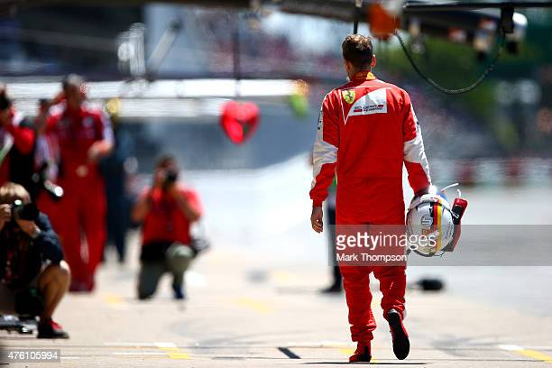 A dejected Sebastian Vettel of Germany and Ferrari walks back to the pits during qualifying for the Canadian Formula One Grand Prix at Circuit Gilles...