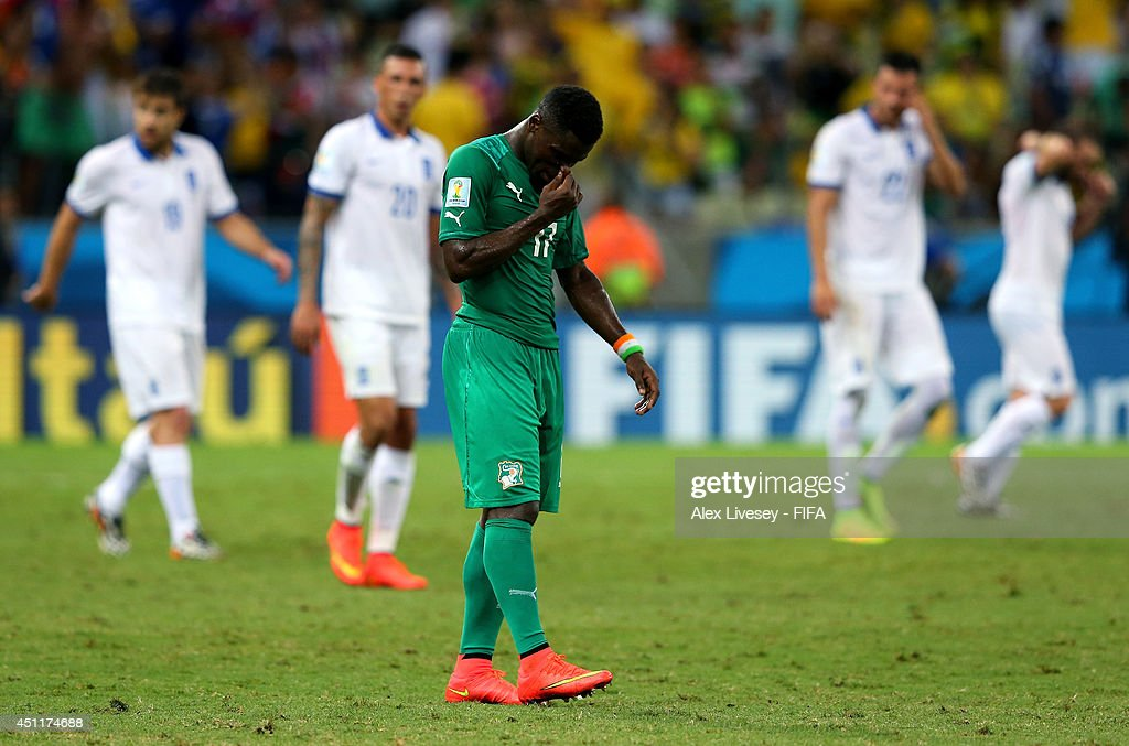 A dejected <a gi-track='captionPersonalityLinkClicked' href=/galleries/search?phrase=Serge+Aurier&family=editorial&specificpeople=6716046 ng-click='$event.stopPropagation()'>Serge Aurier</a> of the Ivory Coast looks on after being defeated by Greece 2-1 during the 2014 FIFA World Cup Brazil Group C match between Greece and Cote D'Ivoire at Estadio Castelao on June 24, 2014 in Fortaleza, Brazil.