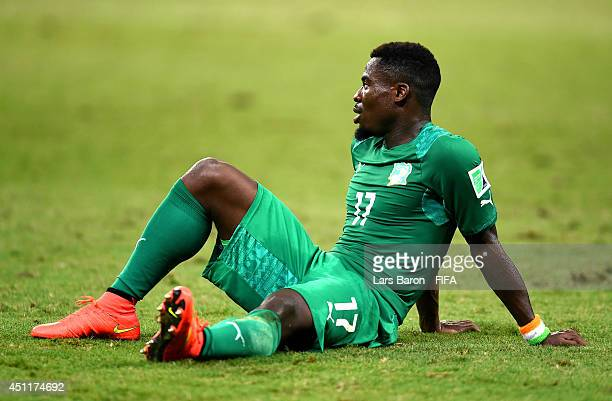 A dejected Serge Aurier of the Ivory Coast sits on the field after being defeated by Greece 21 during the 2014 FIFA World Cup Brazil Group C match...