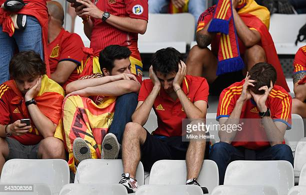Dejected Spain supporters remain in their seats after the UEFA EURO 2016 round of 16 match between Italy and Spain at Stade de France on June 27 2016...