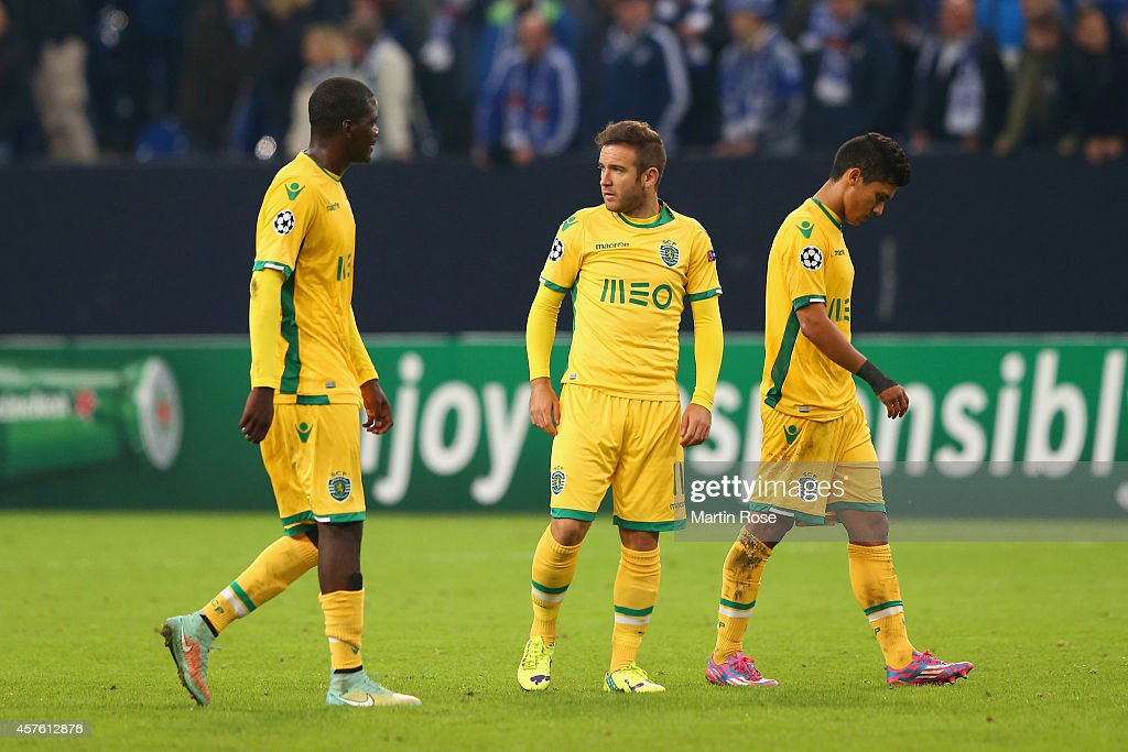 Dejected Sporting players after defeat during the UEFA Champions League Group G match between FC Schalke 04 and Sporting Clube de Portugal at Veltins Arena on October 21, 2014 in Gelsenkirchen, Germany.