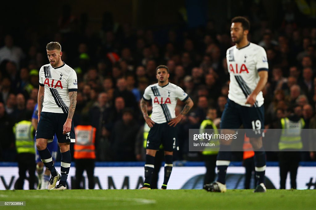 Dejected Spurs players react after conceding a second goal during the Barclays Premier League match between Chelsea and Tottenham Hotspur at Stamford Bridge on May 02, 2016 in London, England.