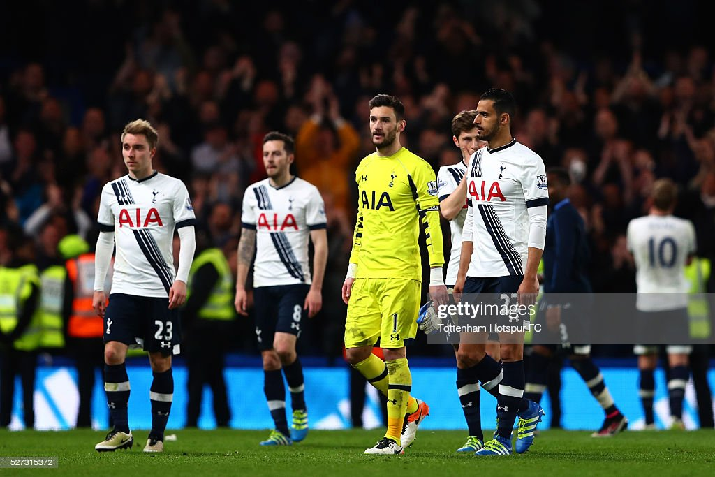 Dejected Spurs players walk of the pitch as Leicester City are crowned champions following the 2-2 draw during the Barclays Premier League match between Chelsea and Tottenham Hotspur at Stamford Bridge on May 02, 2016 in London, England.jd
