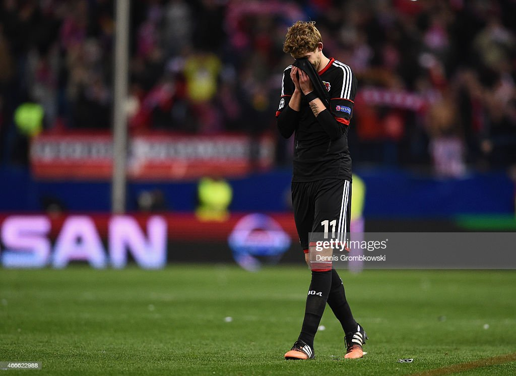 A dejected Stephan Kiessling of Bayer Leverkusen holds his head after missing a penalty in the shoot out during the UEFA Champions League round of 16 match between Club Atletico de Madrid and Bayer 04 Leverkusen at Vicente Calderon Stadium on March 17, 2015 in Madrid, Spain.