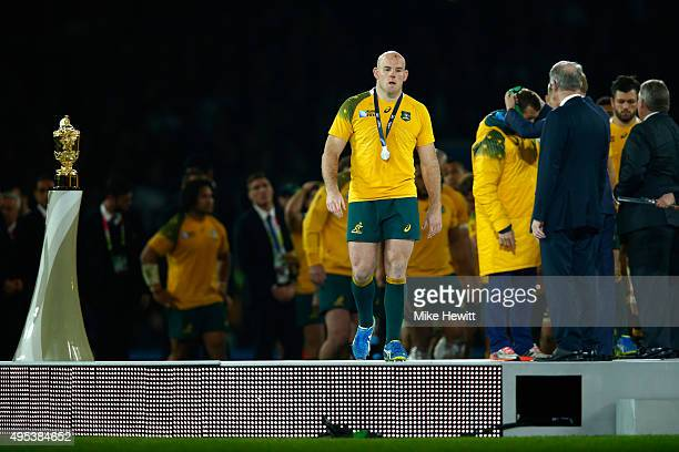 A dejected Stephen Moore of Australia collects his runners up medal during the 2015 Rugby World Cup Final match between New Zealand and Australia at...