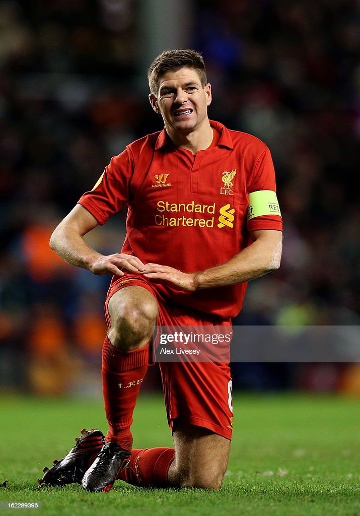 A dejected <a gi-track='captionPersonalityLinkClicked' href=/galleries/search?phrase=Steven+Gerrard&family=editorial&specificpeople=202052 ng-click='$event.stopPropagation()'>Steven Gerrard</a> of Liverpool reacts during the UEFA Europa League round of 32 second leg match between Liverpool FC and FC Zenit St Petersburg at Anfield on February 21, 2013 in Liverpool, England.
