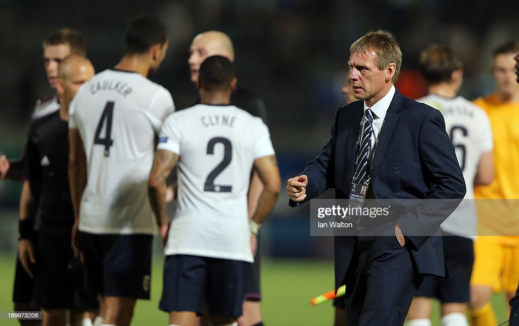 A dejected <a gi-track='captionPersonalityLinkClicked' href=/galleries/search?phrase=Stuart+Pearce+-+Soccer+Coach&family=editorial&specificpeople=213348 ng-click='$event.stopPropagation()'>Stuart Pearce</a> of England after the UEFA European U21 Championships, Group A match between England and Italy at the Bloomfield Stadium on June 5, 2013 in Tel Aviv, Israel.