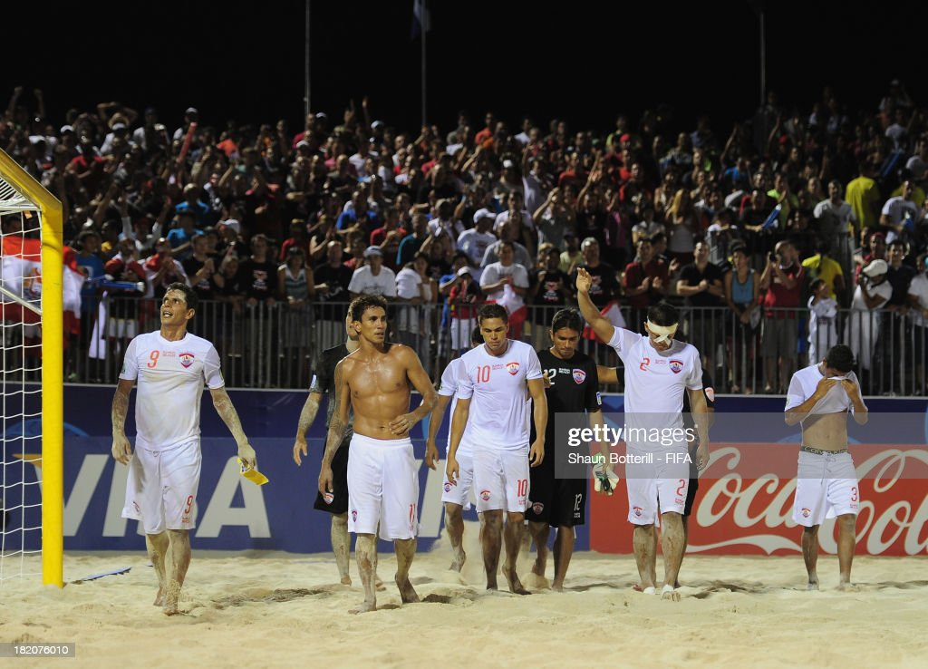A dejected Tahiti team applaud the crowd after losing the FIFA Beach Soccer World Cup Tahiti 2013 Semi Final match between Russia and Tahiti at the Tahua To'ata stadium on September 27, 2013 in Papeete, French Polynesia.