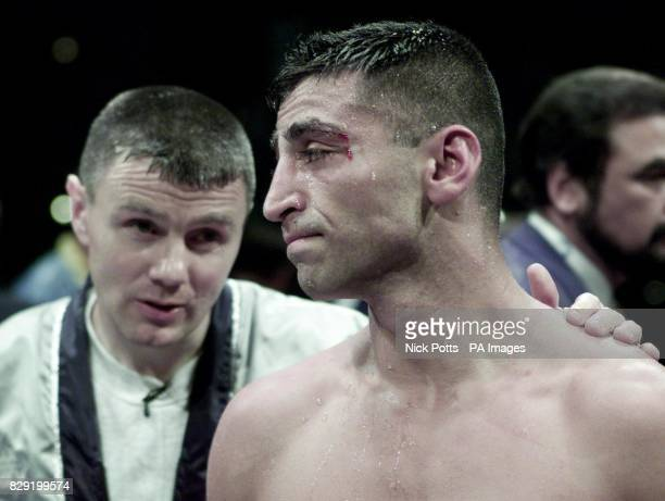 A dejected Takaloo from Margate in consoled by his trainer Jim McDonnell after his challenge for Daniel Santos' World WB0 WBU LightMiddleweight...