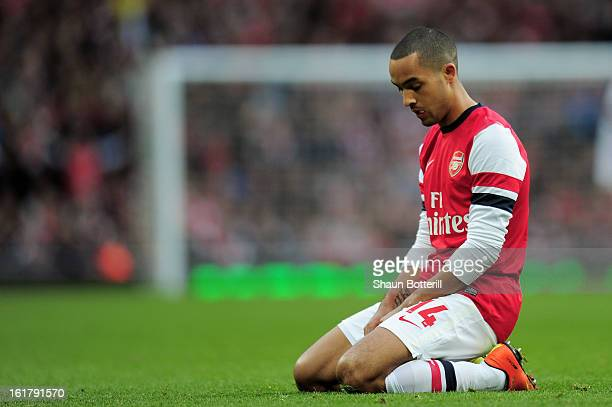 A dejected Theo Walcott of Arsenal looks on during the FA Cup with Budweiser fifth round match between Arsenal and Blackburn Rovers at Emirates...
