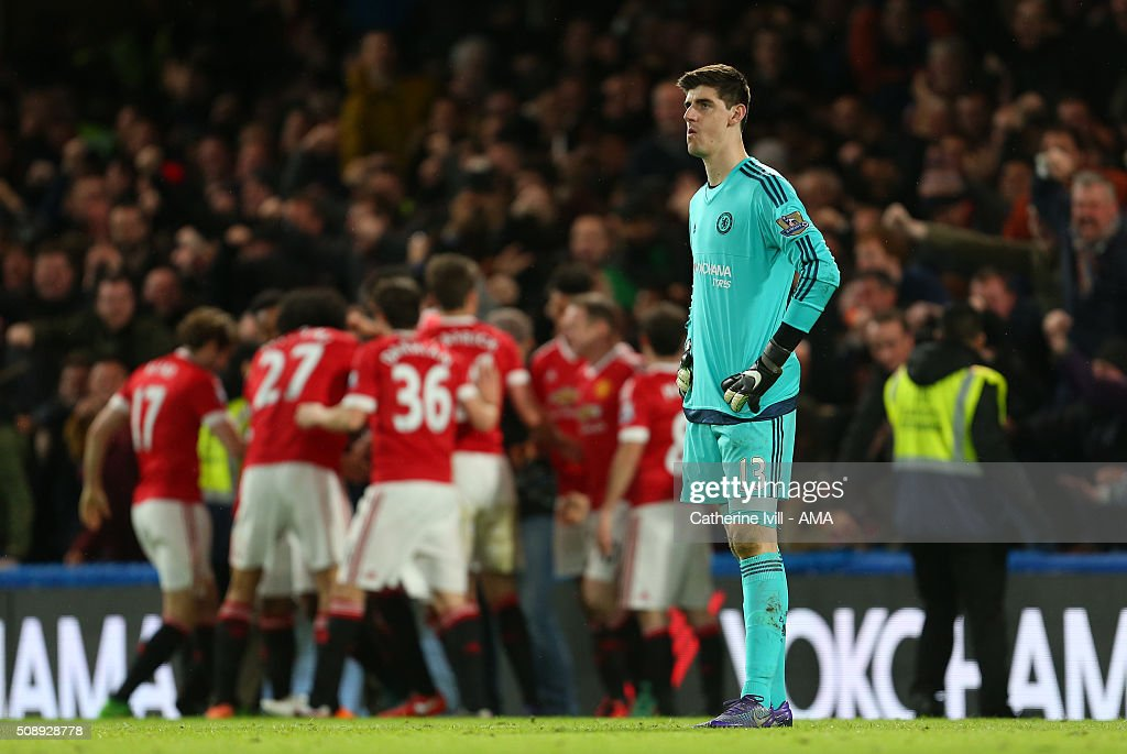 A dejected Thibaut Courtois of Chelsea stands as Jesse Lingard of Manchester United celebrates scoring to make it 0-1 during the Barclays Premier League match between Chelsea and Manchester United at Stamford Bridge on February 7, 2016 in London, England.