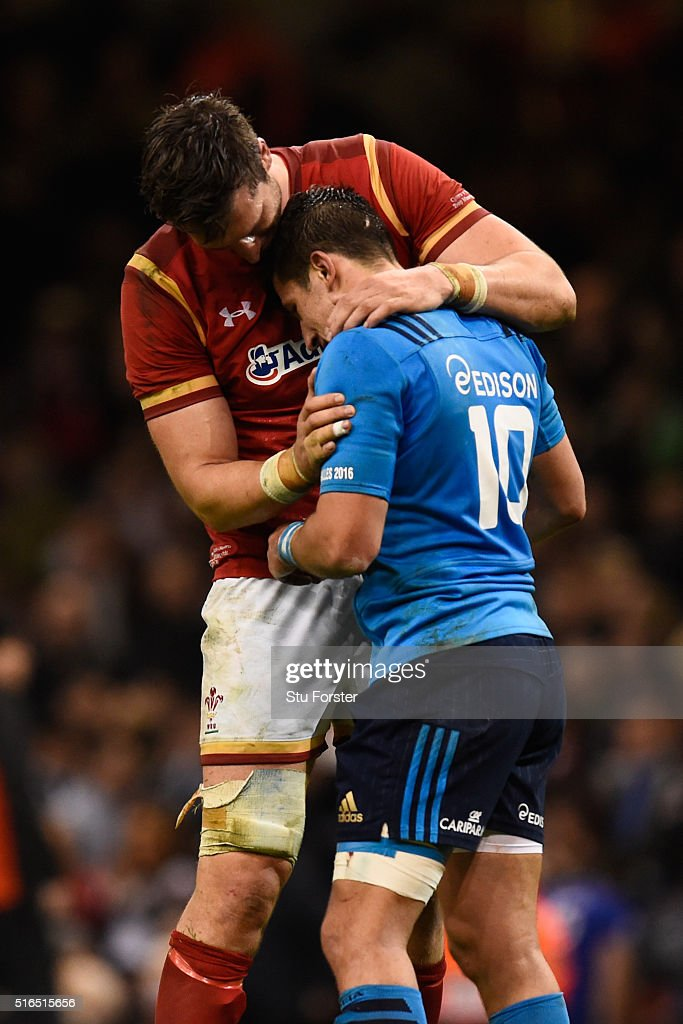 A dejected Tommaso Allan of Italy is consoled by Luke Charteris of Wales following the final whistle during the RBS Six Nations match between Wales and Italy at the Principality Stadium on March 19, 2016 in Cardiff, Wales.
