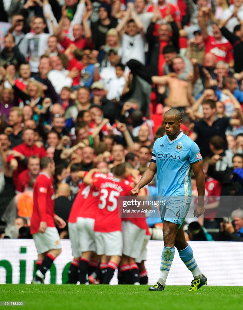 A dejected Vincent Kompany of Manchester City after letting through Nani to score the winning goal