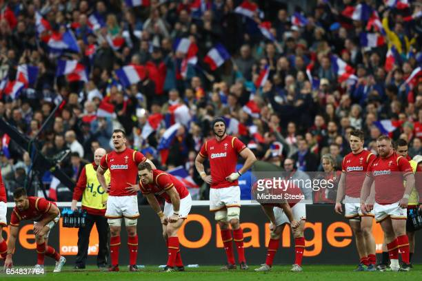 Dejected Wales players look on after conceding a try deep in injury time during the RBS Six Nations match between France and Wales at the Stade de...