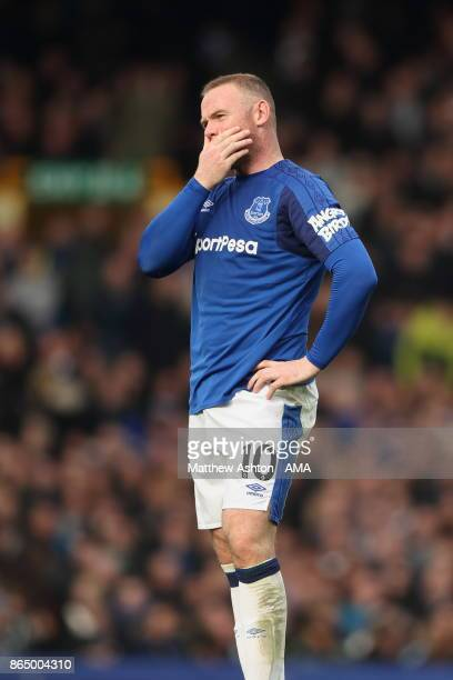 A dejected Wayne Rooney after Arsenal scored their third goal during the Premier League match between Everton and Arsenal at Goodison Park on October...
