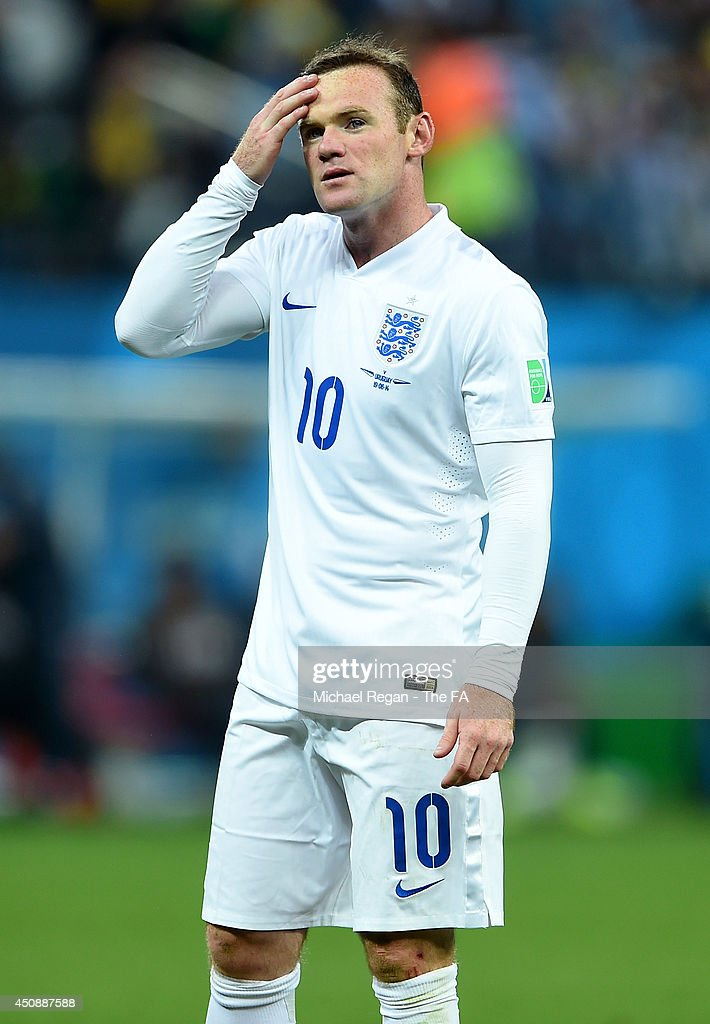 A dejected <a gi-track='captionPersonalityLinkClicked' href=/galleries/search?phrase=Wayne+Rooney&family=editorial&specificpeople=157598 ng-click='$event.stopPropagation()'>Wayne Rooney</a> of England looks on after being defeated by Uruguay 2-1 during the 2014 FIFA World Cup Brazil Group D match between Uruguay and England at Arena de Sao Paulo on June 19, 2014 in Sao Paulo, Brazil.