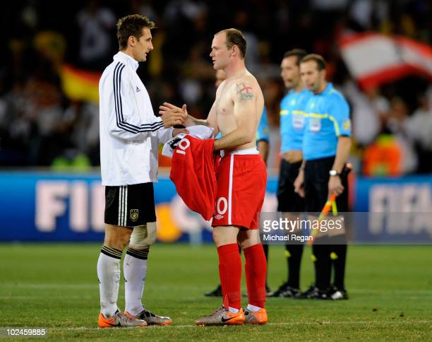 Dejected Wayne Rooney of England swaps shirts with Miroslav Klose of Germany after the 2010 FIFA World Cup South Africa Round of Sixteen match...