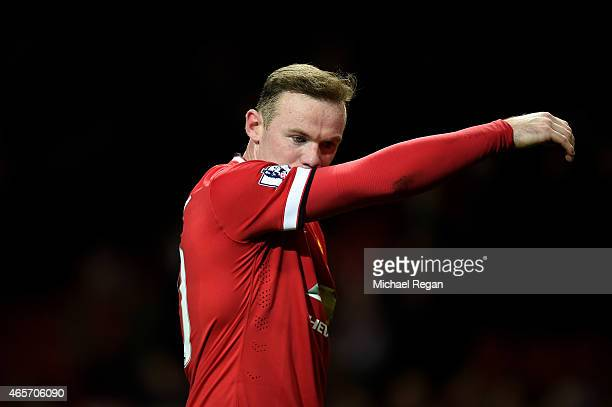 A dejected Wayne Rooney of Manchester United walks off the pitch following his team's 21 defeat during the FA Cup Quarter Final match between...