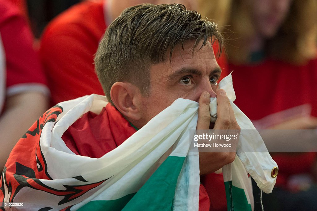 A dejected Welsh football fan looks on while watching the Wales v Portugal Euro 2016 semi-final match on a big screen in the Principality Stadium on July 6, 2016 in Cardiff, Wales. Portugal beat Wales 2-0 at Stade de Lyon in France, knocking Wales out of the competition.