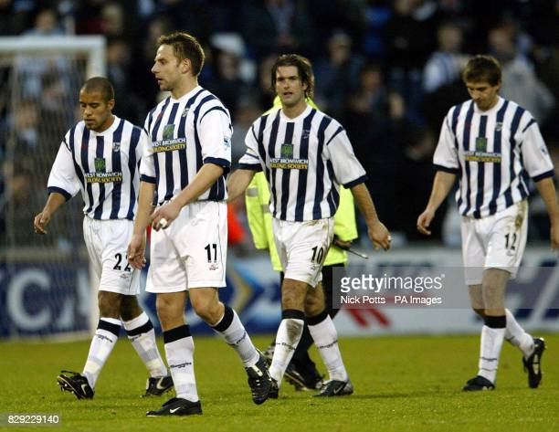 Dejected West Bromwich Albion players James Chambers Larus Sigurdsson Andy Johnson Scott Dobie leave the field after losing their Barclaycard...