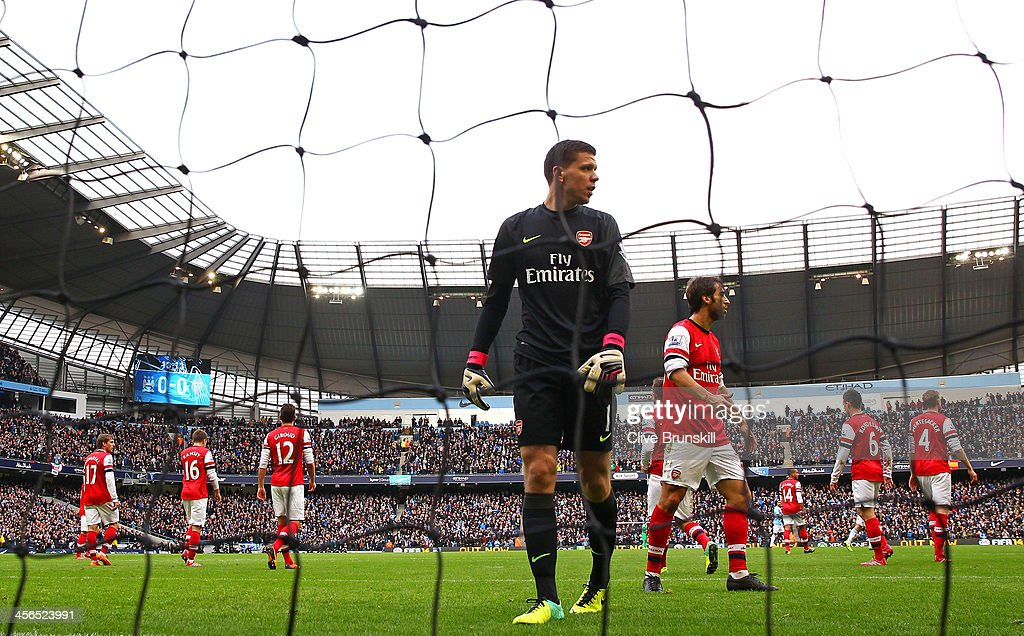 A dejected <a gi-track='captionPersonalityLinkClicked' href=/galleries/search?phrase=Wojciech+Szczesny&family=editorial&specificpeople=6539507 ng-click='$event.stopPropagation()'>Wojciech Szczesny</a> of Arsenal looks on after the first goal from Sergio Aguero of Manchester City (not pictured) during the Barclays Premier League match between Manchester City and Arsenal at Etihad Stadium on December 14, 2013 in Manchester, England.