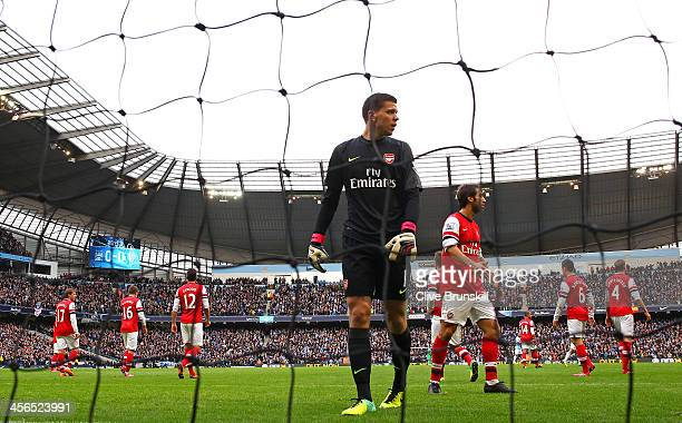 A dejected Wojciech Szczesny of Arsenal looks on after the first goal from Sergio Aguero of Manchester City during the Barclays Premier League match...