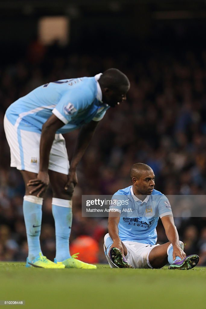 A dejected Yaya Toure and Fernandinho of Manchester City after Tottenham Hotspur scored a goal to make it 1-2 during the Barclays Premier League match between Manchester City and Tottenham Hotspur at the Etihad Stadium on February 14, 2016 in Manchester, England.